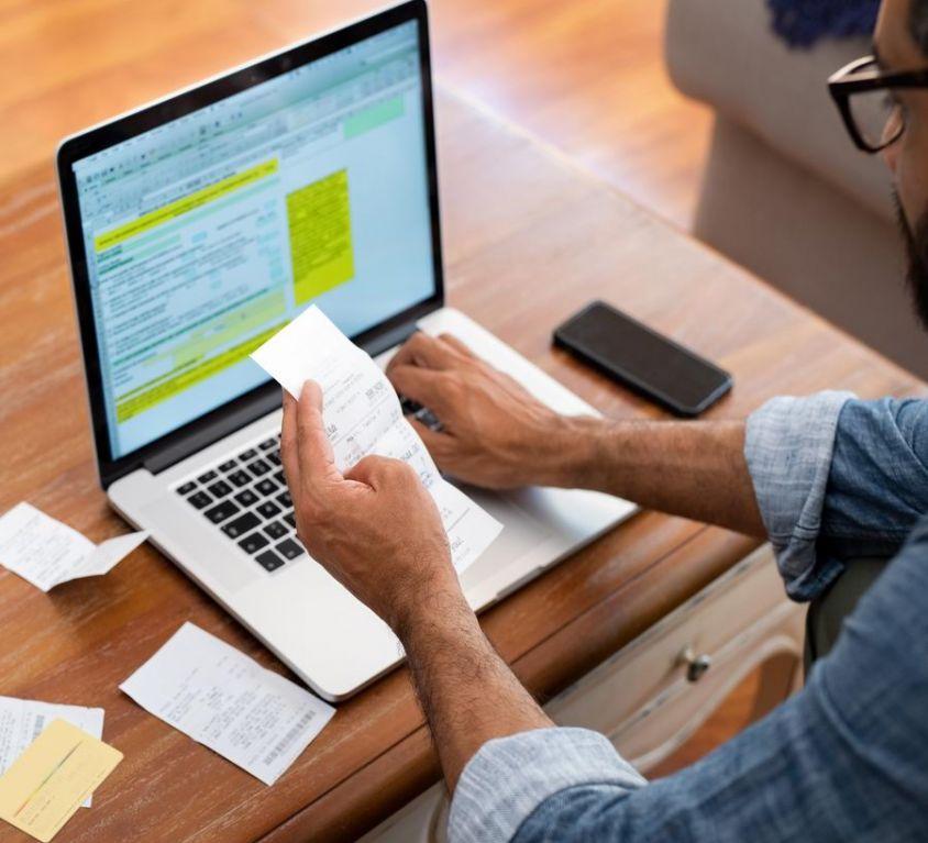 Canva - Man Checking Bills at Home