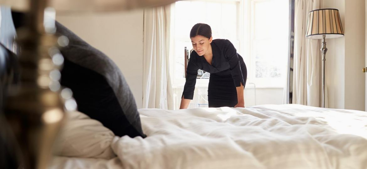 Canva - Chambermaid Changing Bed Linen on the Bed in a Hotel Room