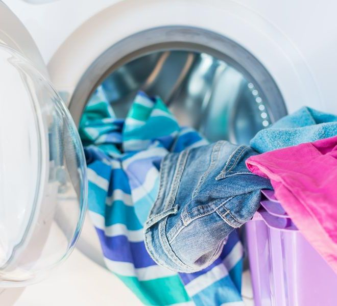 Canva - Colorful clothes in laundry basket